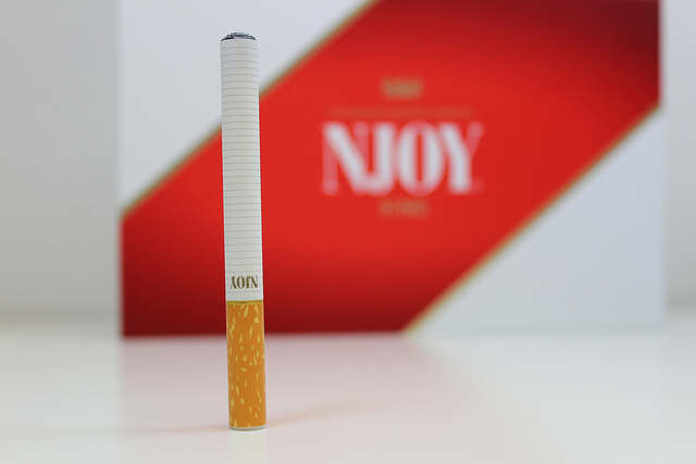 Looks like a cigarette...but it's not one! It's an electronic cigarette.