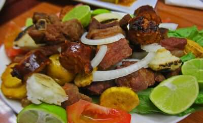 Four fried proteins and three carbs make up the Picada - Anotjitos Colombianos, San Diego